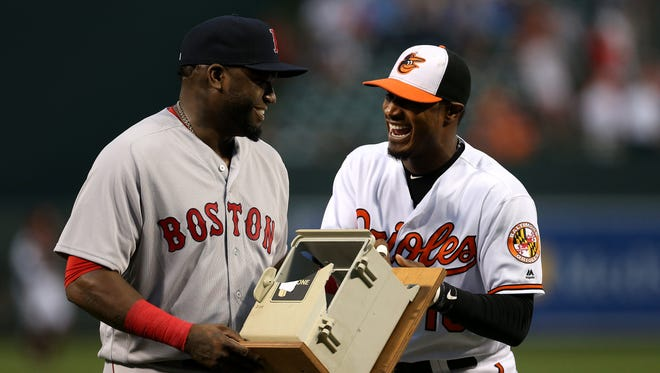 Adam Jones presents David Ortiz with the dugout telephone Ortiz broke on July 27, 2013 during his retirement ceremony at Oriole Park at Camden Yards.