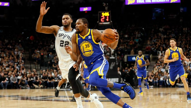 Golden State Warriors forward Kevin Durant injured his ankle in a win over the San Antonio Spurs.