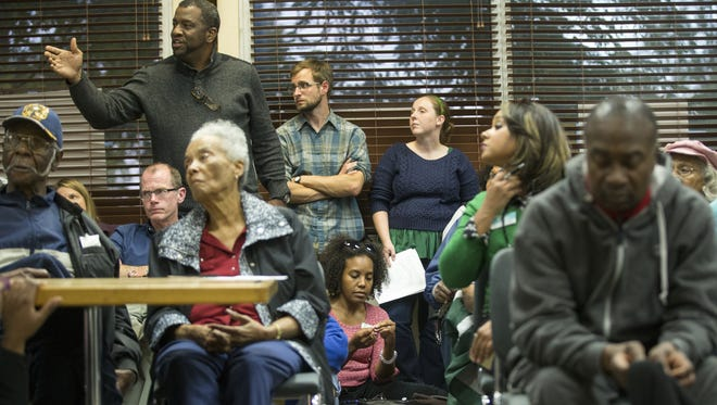City-County Councilman Joseph Simpson (back left) said one of the steps the city can take to curb the violence is to get rid of the landlords who are harboring drug dealers. Simpson spoke at the Butler-Tarkington Neighborhood Association meeting Monday, Oct. 19, 2015.