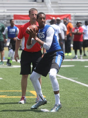 Sam Johnson of Southfield goes through drills during the Sound Mind Sound Body football camp at Wayne State on June 10, 2016.