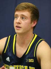 Michigan guard spike Albrecht talked with reporters