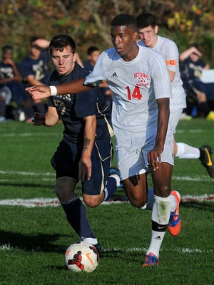 David Siriboe, number 14, battles Dimas Arroyo for the ball during a match two years ago. Siriboe now plays for the Kingston Stockade, which is playing its first-ever playoff game Saturday at Dietz Stadium.