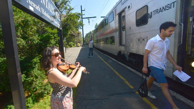 Montclair violinist Amy Beshara plays for commuters at the Mountain Avenue railroad station in partnership with the NJ Transit's Music in Motion Program for Make Music Day last year.