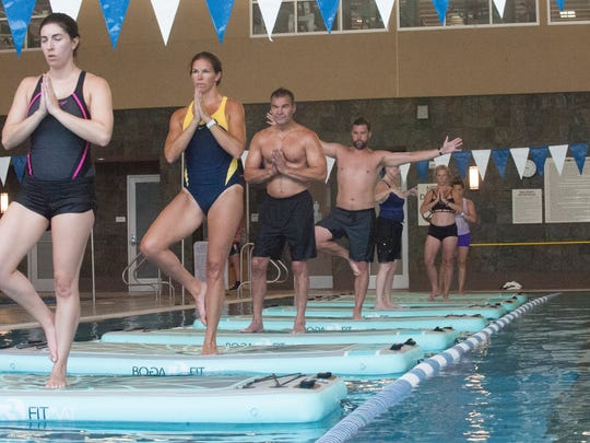 From left, Lisa Marino, Jennifer Stansky, Ken Koczur, Rich Shevchenko, Jody Santangelo, Bethany Liggett, and Diana Aguirre, take part during a water yoga class at the  LifeTime Athletic Center on Church Road in Mount Laurel.