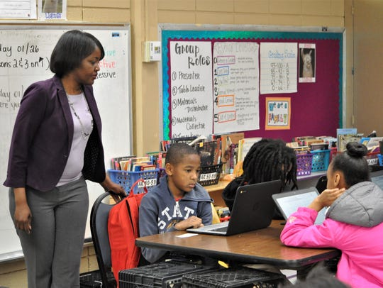 New Principal Tracy Vorrice looks at the work of an