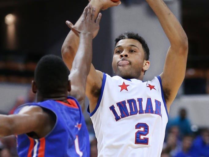 Indiana's James Blackmon Jr. fires a shot over Kentucky's Christen Cunningham in the first half of the Indiana High School All-Stars game.