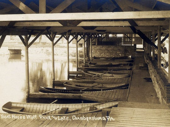 An ample supply of boats await you at the boathouse at Wolf's Park so you can navigate your way around the famous lake in the early 1900's.
