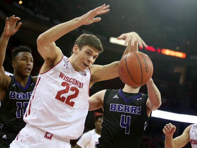 Badgers forward Ethan Happ tries to grab a loose ball.