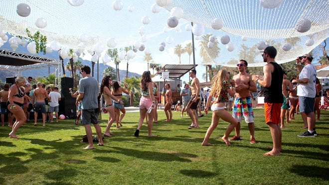 Attendees of Splash House dance to EDM music at the Hacienda Cantina and Beach Club on Saturday.