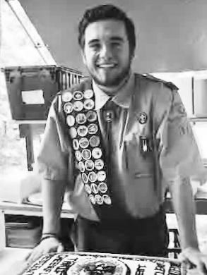 Scout Erik Kuhn celebrates his Eagle Scout award at Camp Dill in Clinton Township.