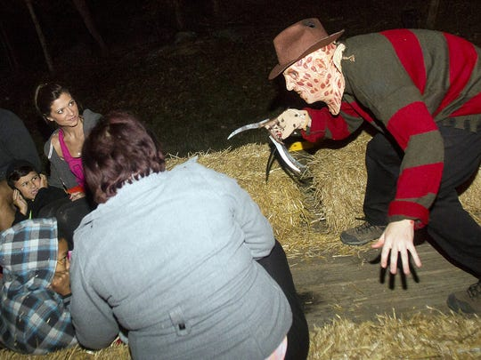 Freddy Krueger, of 'A Nightmare on Elm Street' fame, terrorizes the trailer along Old Scream Road on the Haunted Hayride at the Barfield Halloween Bash.