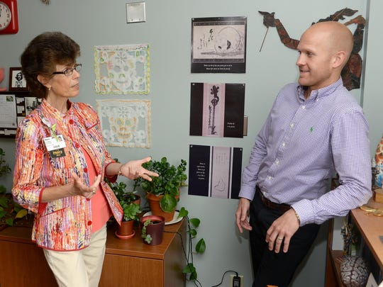 Andria Balicki, director of outpatient behavioral health at Inspira Health Center Bridgeton, talks with social worker Joe O'Brien in his office, Wednesday, Jun. 3, 2015 in Bridgeton.