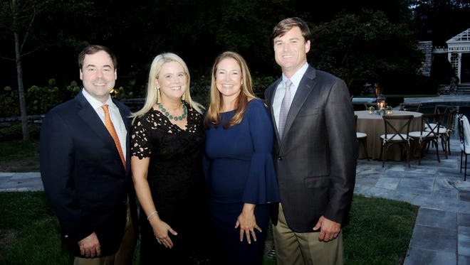 Swan Ball 2017 co-chair Amy Liz Riddick, second from left, and Jody Hull, with their husbands John, left, and Rob, right, at the Swan Ball 2017 Auction Committee Kick Off, held at the home of Barbara and Greg Hagood.