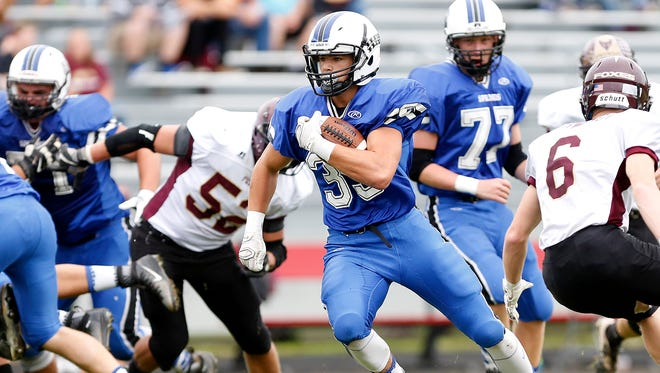 St. Mary's Springs' Clay Schueffner runs with the ball in the Ledgers' win against Omro on Saturday at Fruth Field.