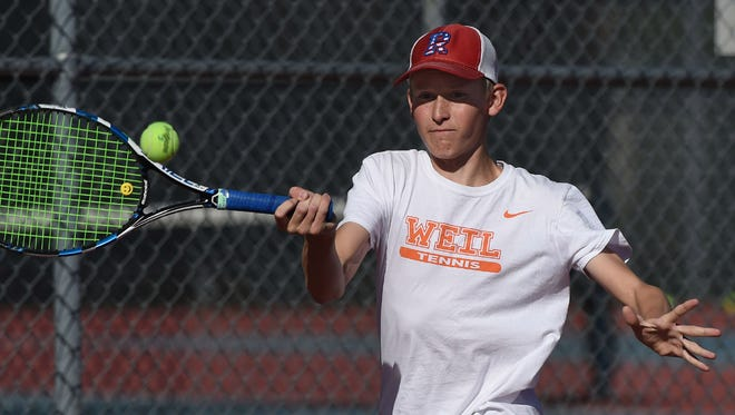 Reno's Miki Tiilikainen hits a forehand return during practice at Reno High School on Monday.