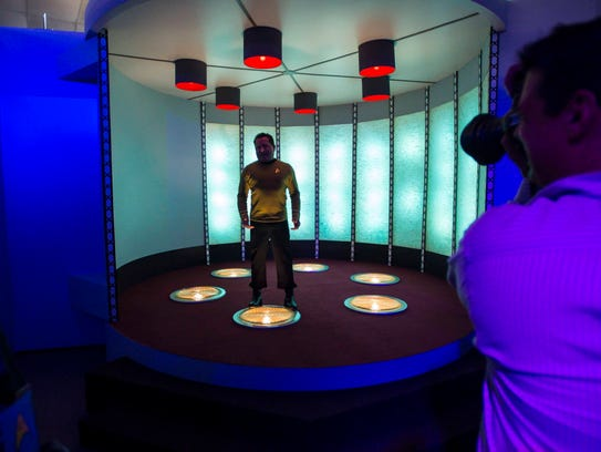 Visitors tour a replica of the transporter room on