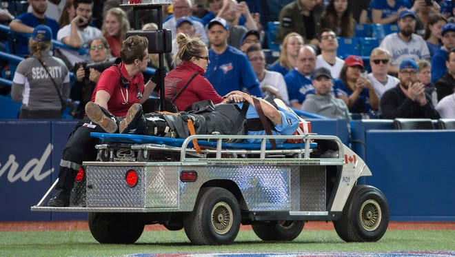 Home plate umpire Dale Scott is taken off the field by stretcher and emergency vehicle after being hit with a foul tip in the eighth inning of a game between the Baltimore Orioles and the Toronto Blue Jays at Rogers Centre.