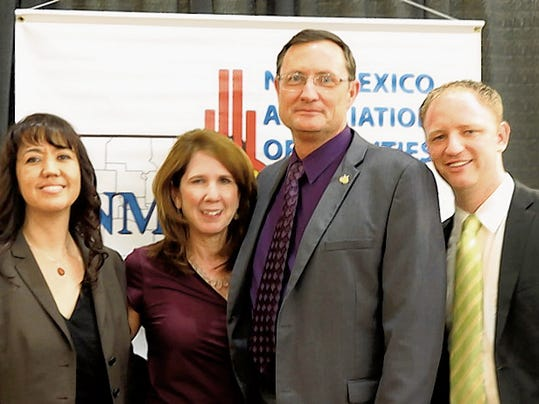 Courtesy Photo From left, are past president of the New Mexico Association of Counties, Paula Garcia; Sharon Stover, Clyde Ward and Tyler Massey.