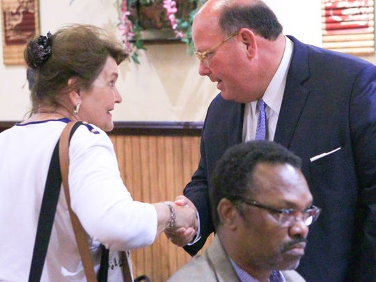 Norma Hughes-Smith (left) of Belton shakes hands with Ed McMullen, South Carolina campaign chairman and adviser to Donald Trump, during the 1st Monday Club meeting at Master's Wok in Anderson.