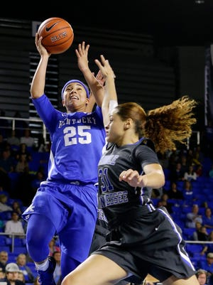 Kentucky guard Makayla Epps (25) shoots over the reach of Middle Tennessee forward Tianna Porter (31) in the first half of an NCAA college basketball game Sunday, Dec. 13, 2015, in Murfreesboro, Tenn. (AP Photo/Mark Humphrey)