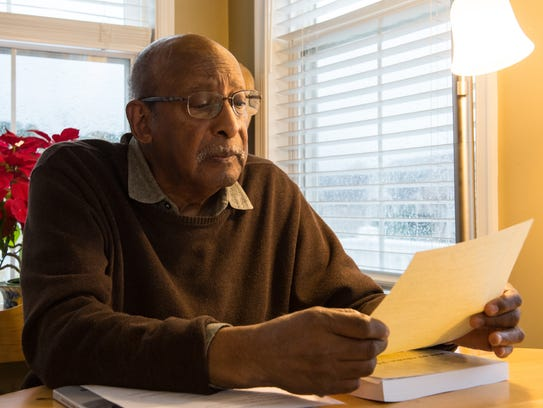 The Rev. David Briddell reads a document at his home on Tuesday, Jan. 23, 2018.