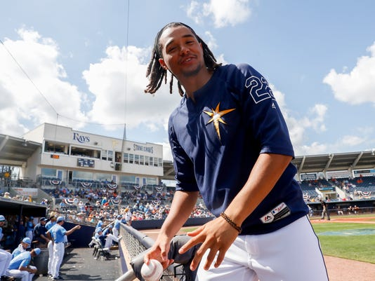 Tampa Bay Rays' Chris Archer reacts in the dugout in the third inning of a spring training baseball game against the Baltimore Orioles, Tuesday, Feb. 27, 2018, in Port Charlotte, Fla. (AP Photo/John Minchillo)