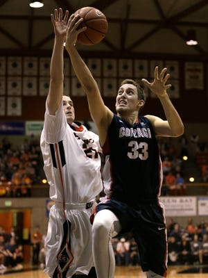 Gonzaga forward Kyle Wiltjer, right, drives to the basket against Pacific forward Jacob Lampkin during the second half of an NCAA college basketball gameThursday,Feb. 19, 2015 in Stockton, Calif.  Gonzaga won 86-74.