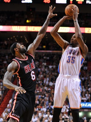 Thunder forward Kevin Durant shoots over Heat forward LeBron James in their Jan. 29 meeting, which Durant's Thunder won.