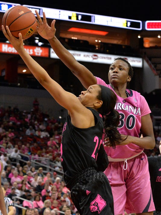 Louisville guard Asia Durr (25) attempts a layup past the defense of Virginia center Felicia Aiyeotan (30) during the second half of an NCAA college basketball game, Thursday, Feb. 22, 2018, in Louisville, Ky. (AP Photo/Timothy D. Easley)