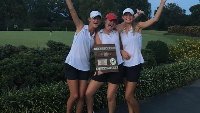USJ's girls golf team of Jill Yates, Fances New and Shelby Hatchett (left to right) celebrate after winning the Division II-A West region tournament.