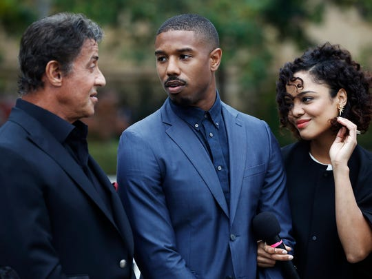 """Sylvester Stallone, from left, Michael B. Jordan and Tessa Thompson talk before a press conference promoting their film """"Creed"""" outside the Philadelphia Museum of Art, Friday, Nov. 6, 2015, in Philadelphia."""