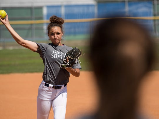 Carroll High School freshman pitcher Vanessa Quiroga warms up during practice at the school's softball field on Tuesday, May 15, 2018.