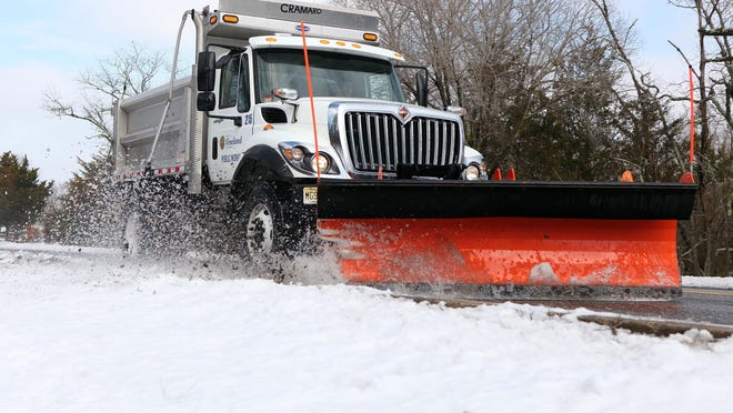 A Vineland Public Works snowplow clears slush from Mill Road in February 2015.