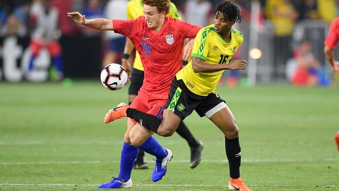 U.S. forward Josh Sargent (19) battles for the ball against Jamaica midfielder Peter Vassell (16) during the second half of an international friendly soccer match Wednesday, June 5, 2019, in Washington. Jamaica won 1-0. (AP Photo/Nick Wass)