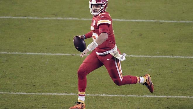 Kansas City Chiefs quarterback Patrick Mahomes (15) runs during the second half Sunday against the Denver Broncos in Kansas City, Mo.