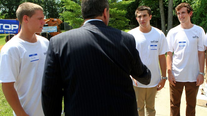 Gov. Chris Christie meets Daytop New Jersey clients (from left) Mike S., 18, of Brigantine; John F., 18, of Pine Hill; and Conrad Peclet, 17, of Manchester  at Wednesday's groundbreaking  at the  addiction treatment facility in Pittsgrove.