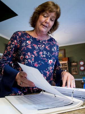 Charlotte Meadows looks through paperwork as she discusses LEAD Academy at her home in Montgomery, Ala. on Tuesday March 6, 2018.