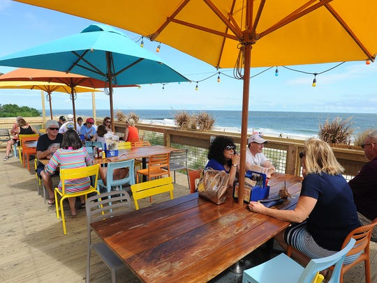 Big Chill Beach Club offers expansive views of the Atlantic Ocean, the Indian River Inlet Bridge and Indian River Bay.
