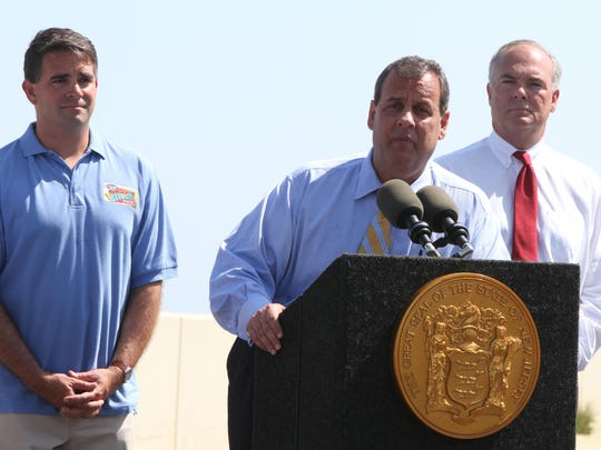 Gov. Chris Christie speaks during a press conference in Belmar on May 29. Behind Christie is Belmar Mayor Matt Doherty (left) and Commissioner Bob Martin of the state Department of Environmental Protection. The Christie administration wants to repeal and rewrite the Water Quality Management Planning rules, with an eye on nudging the state out of its economic slump.