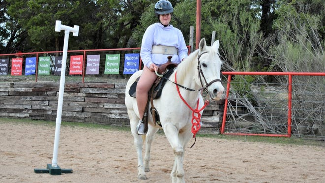 Special Olympics athlete Reagan Lowman demonstrates her horseback riding skills at Red Arena this spring.