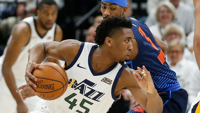 Utah Jazz guard Donovan Mitchell (45) drives around Oklahoma City Thunder forward Corey Brewer (3) in the first half during Game 4 of an NBA basketball first-round playoff series, Monday, April 23, 2018, in Salt Lake City. (AP Photo/Rick Bowmer)
