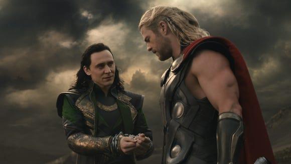 Loki (Tom Hiddleston) and Thor (Chris Hemsworth) promote