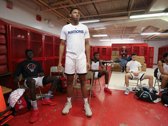 Charles Bassey listens to pre-game instructions before Aspire's game against Orangeville Prep at Seneca High School in February.