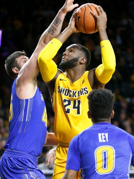 Wichita State's Shaquille Morris (24) goes up for two against South Dakota State's Ian Theisen during the first half of an NCAA college basketball game at Koch Arena in Wichita, Kan., Tuesday, Dec. 5, 2017. (Fernando Salazar/The Wichita Eagle via AP)