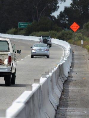 CHUCK KIRMAN/THE STAR Concrete barriers have been installed in several areas on the shoulder of Highway 33 between Main Street in Ventura and Casitas Vista Road north of Ventura. Caltrans plans installations to control and reduce pollution from stormwater runoff.