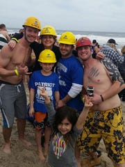 """Employees from Gerdau's Sayreville steel mill braved the 41 degree ice-cold water plunging into the Atlantic Ocean on Feb. 20 to raise money for Special Olympics New Jersey. This is the eighth year employees have participated in the event, and this year, Gerdau's 17 participants raised more than $1,800 this year. """"I am proud of our employees for taking the plunge into the freezing water for this great cause,"""" said Mark Quiring, the vice president and general manager of the Sayreville mill. """"Their efforts make such a huge impact on so many lives throughout our state by giving them continued opportunities to develop physically."""" The Seaside Heights Polar Plunge is organized by the Law Enforcement Torch Run for Special Olympics New Jersey, and supported by New Jersey State Policeman's Benevolent Association. More than 6,000 people participated in the event, which raised $1.7 million, the highest amount raised in the event's 23 year history. Proceeds of the event will support year-round sports training and competition for various sports for children and adults with intellectual disabilities."""