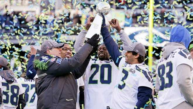 Seattle Seahawks owner Paul Allen, left, celebrates with players after winning Super Bowl XLVIII in 2014.