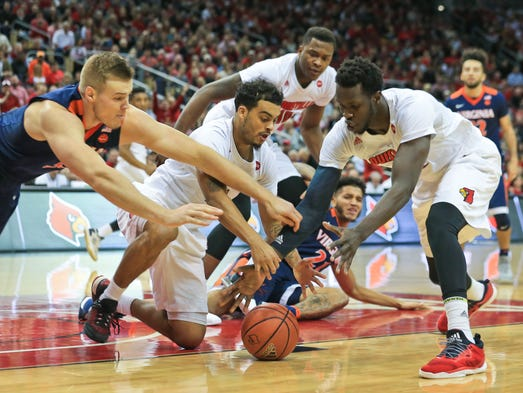 Louisville's Quentin Snider scrambles for a loose ball