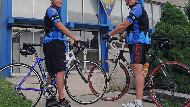 """Starting on Sept. 11, Vineland police officers Terry Hall (left) and Dwight Adams will participate in the four-day """"Tour de Force"""" memorial bike ride from Boston Marathon finish line to New York City's Freedom Tower."""