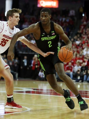 Michigan State Spartans forward Jaren Jackson Jr. (2) dribbles the ball around Wisconsin Badgers forward Nate Reuvers (35) during the first half at the Kohl Center.Feb 25, 2018; Madison, WI.